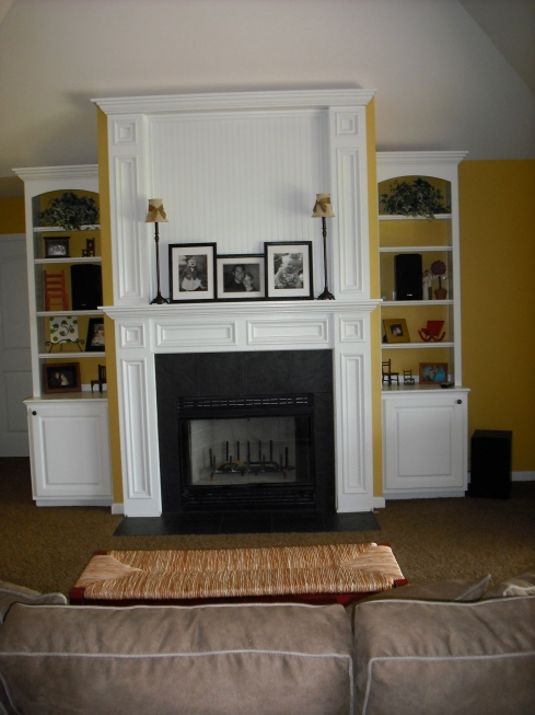 Our beautiful customer woodwork and cabinets are the fireplace.